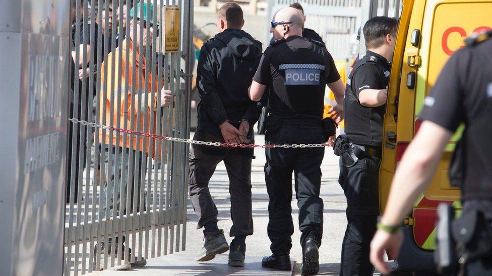 Officers detain man