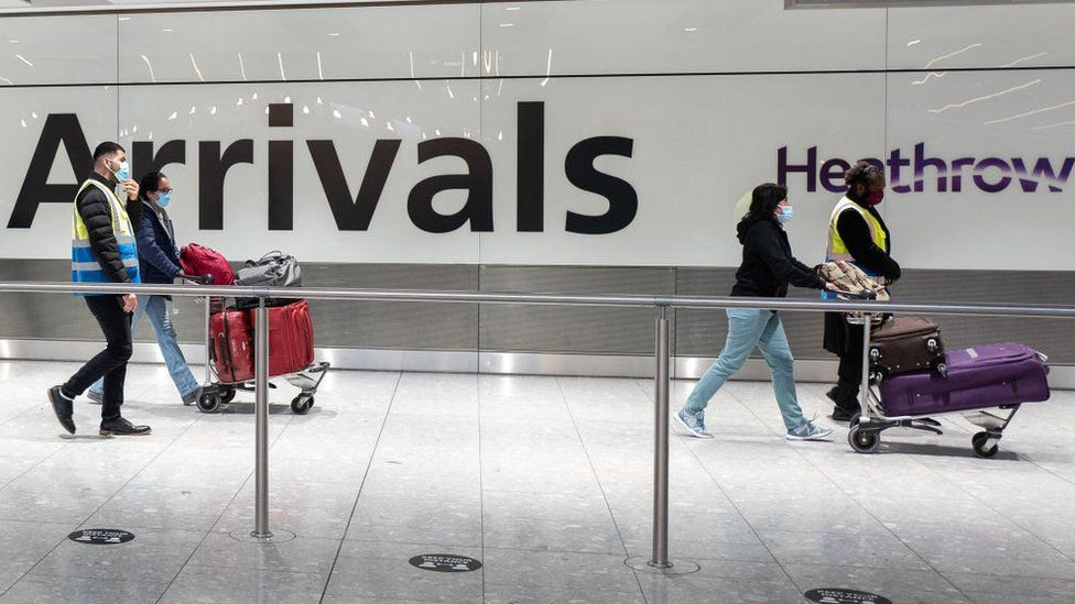 Travellers arrive at Heathrow Terminal 5