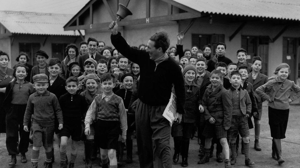 Kindertransport children at Dovercourt Bay, led by Trevor Chadwick