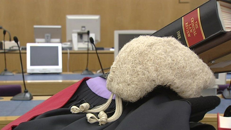barrister gown and wig in a courtroom