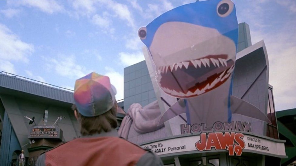 Marty McFly portrayed by Michael J. Fox in the 1989 film Back to the Future II stands outside the cinema where Jays is showing