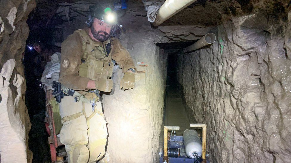 A US Customs and Border Protection (CBP) agent at a tunnel