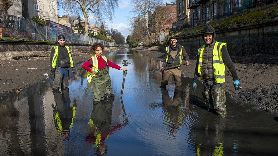Volunteers clearing out the rubbish from the Hertford Union Canal