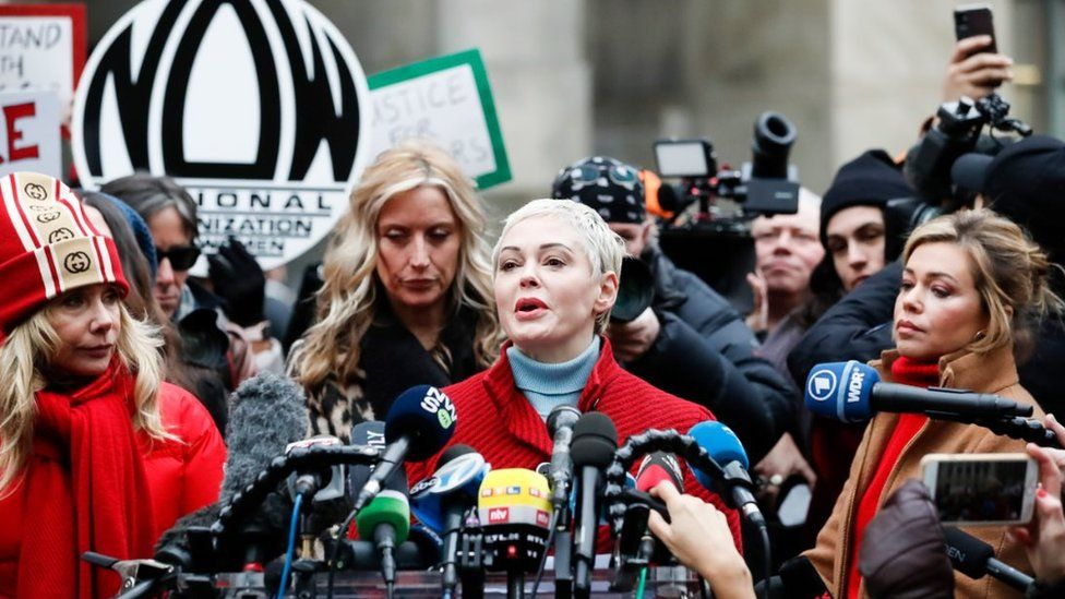 Actress Rose McGowan (2-R) talks to journalists during a press conference with other women who have all accused former Hollywood producer Harvey Weinstein