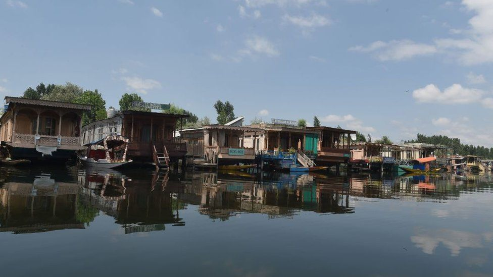 Empty houseboats on Srinagar's Dal lake.