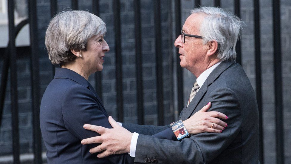 Britain's Prime Minister, Theresa May, greets European Commission president, Jean-Claude Juncker, as he arrives at 10 Downing Street on April 26, 2017