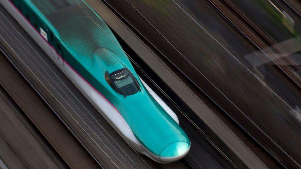 Aerial shot of shinkansen train at speed