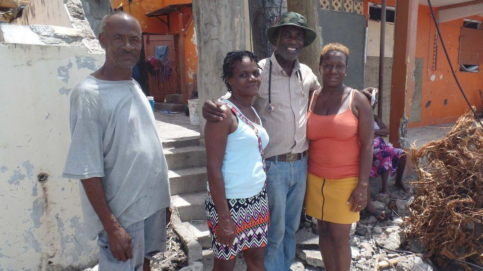 Dr Sam Christian posing with residents of Scott's Head
