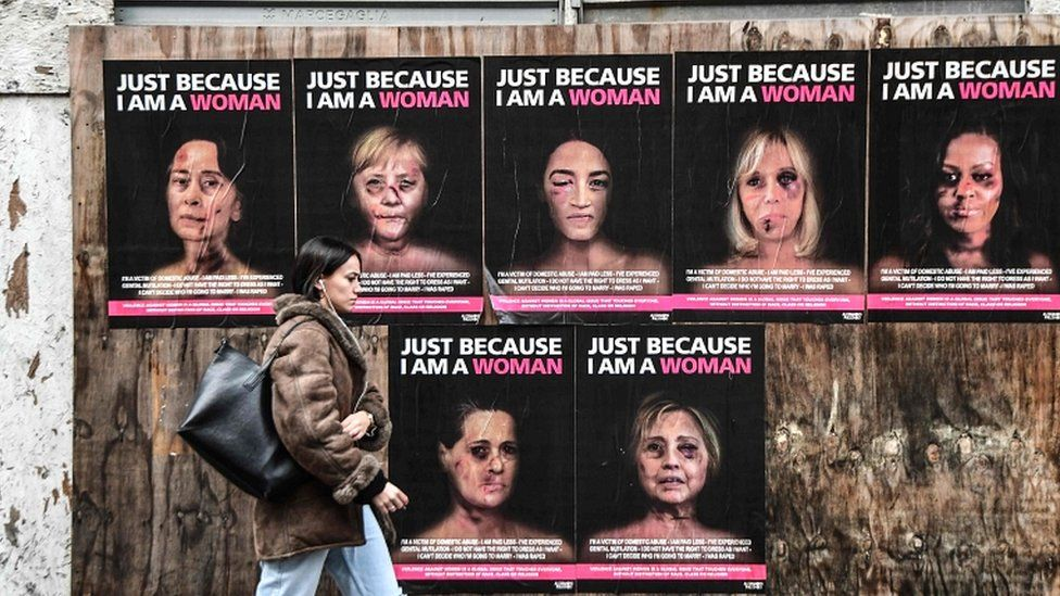 Violence against women: 'Battered faces' poster campaign appears in Milan