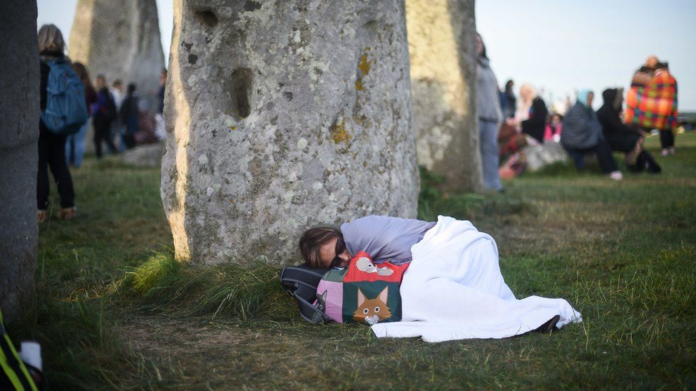 Woman sleeping near Stonehenge