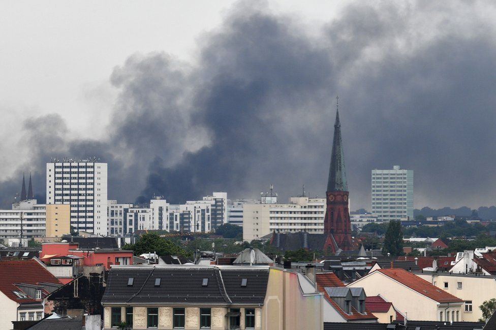 Smoke hangs over the Schanzenviertel district of Hamburg, 7 July
