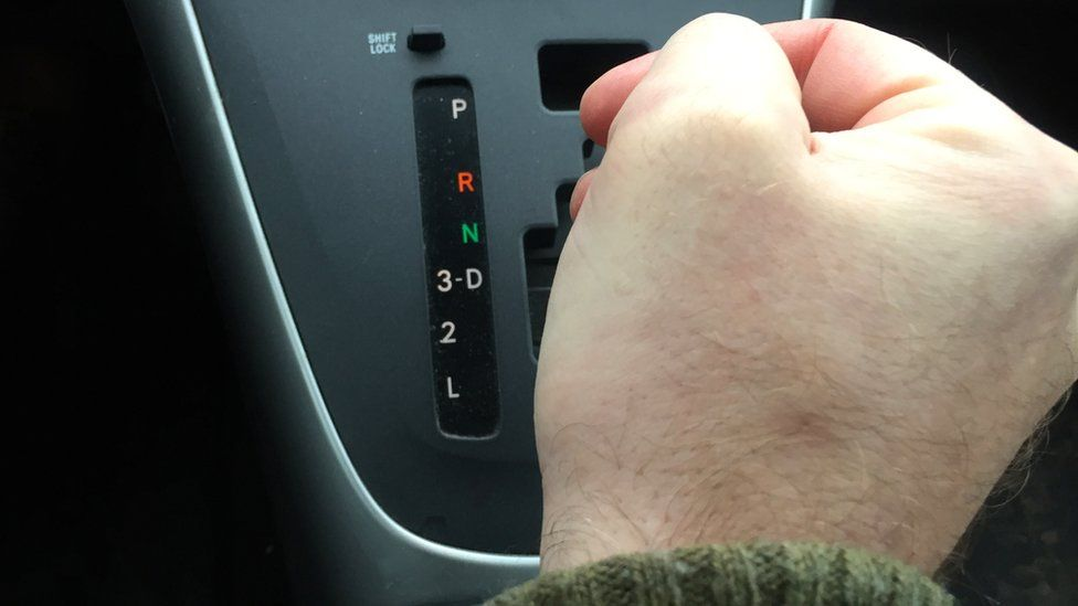 Man using automatic gears