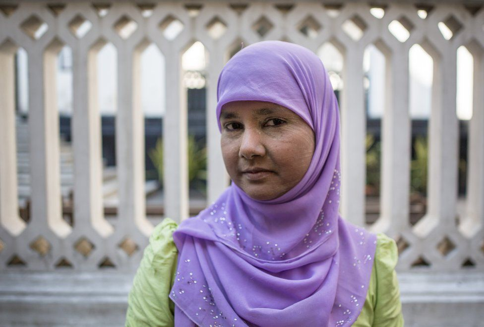 Thwarhairah poses for a portrait in downtown Yangon, Myanmar, November 14, 2015. For fifteen years