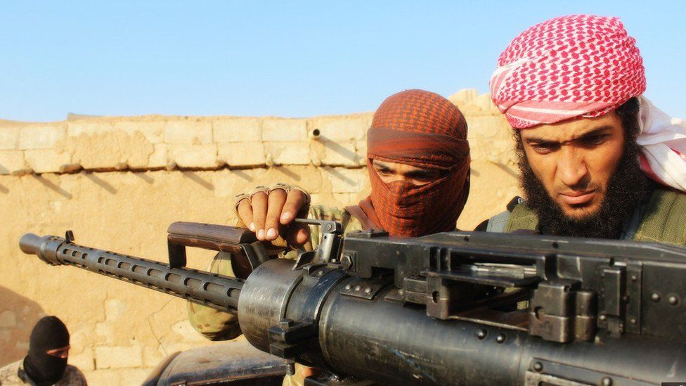 IS propaganda showing militants with guns