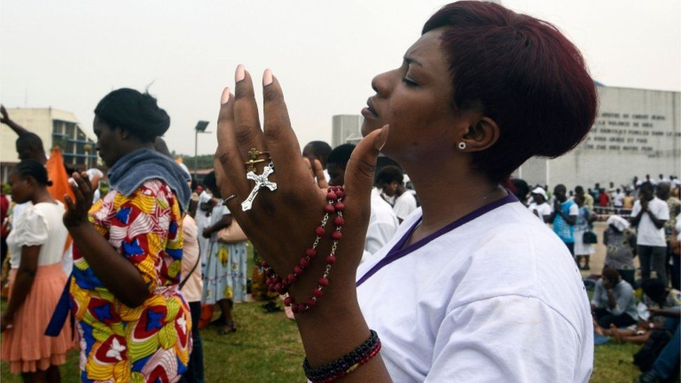 Catholics gather to pray on the premises of the Saint-Paul Cathedral in Abidjan on 15 February 2020.