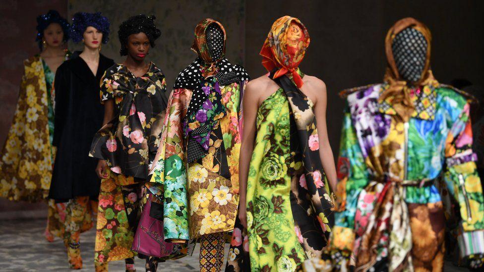Models present creations by Richard Quinn