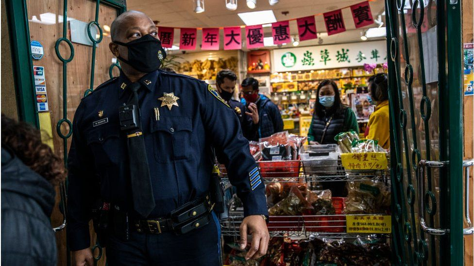 Police presence outside a San Francisco Asian grocery store due to increased violence