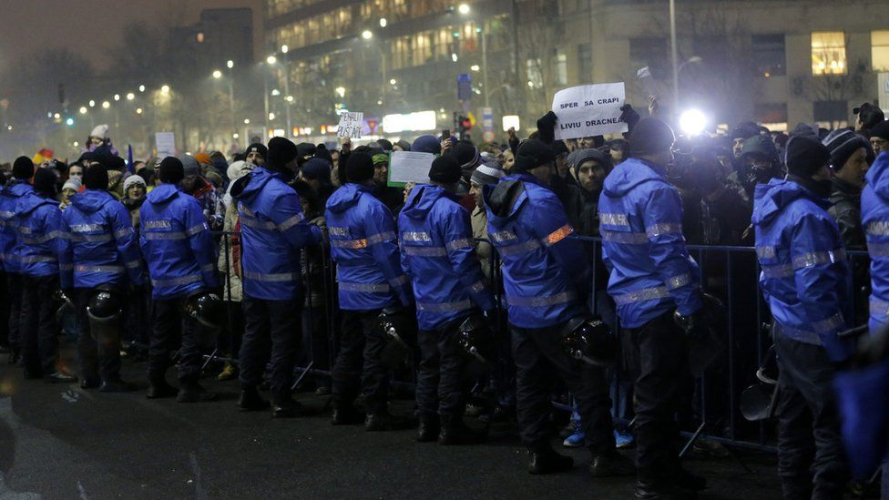 Riot police guard government headquarters during a protest in Bucharest, Romania, 22 January 2017