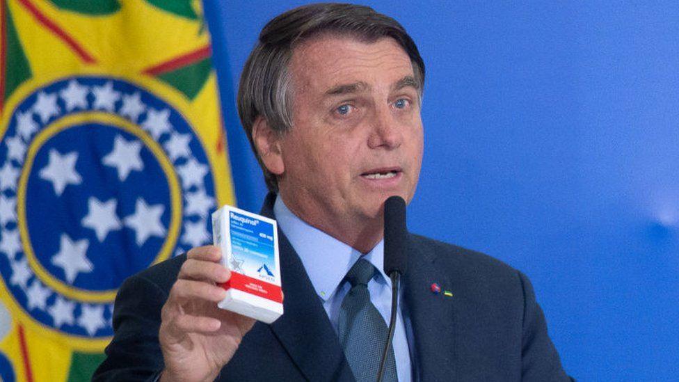 President of Brazil Jair Bolsonaroshows a box of chloroquine medicine on 16 September 2020