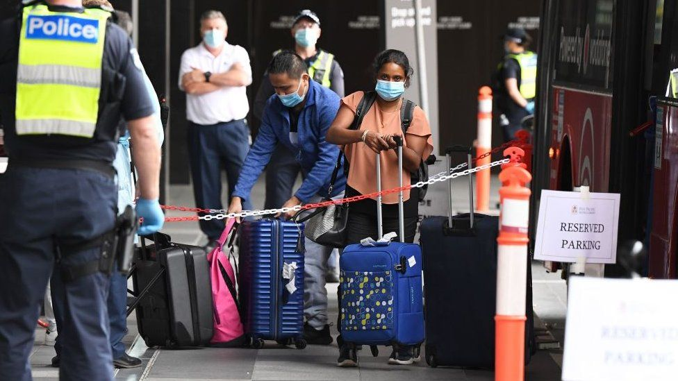 Returning Australian passengers shepherded by police into hotel quarantine