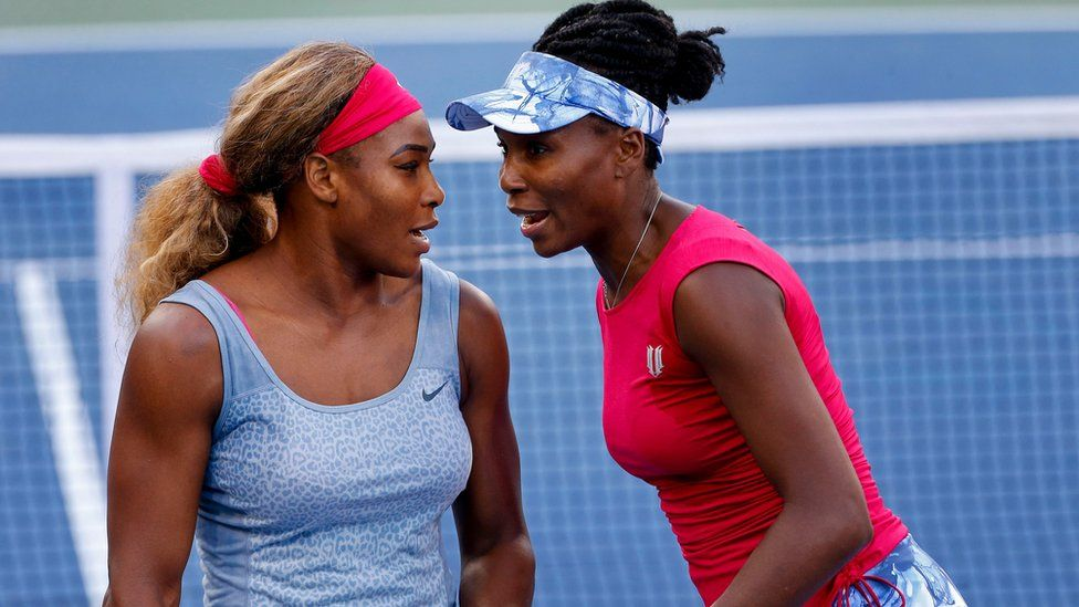 In this Aug. 28, 2014, file photo, Serena Williams, left, and Venus Williams talk during a doubles match at the 2014 U.S. Open tennis tournament, in New York