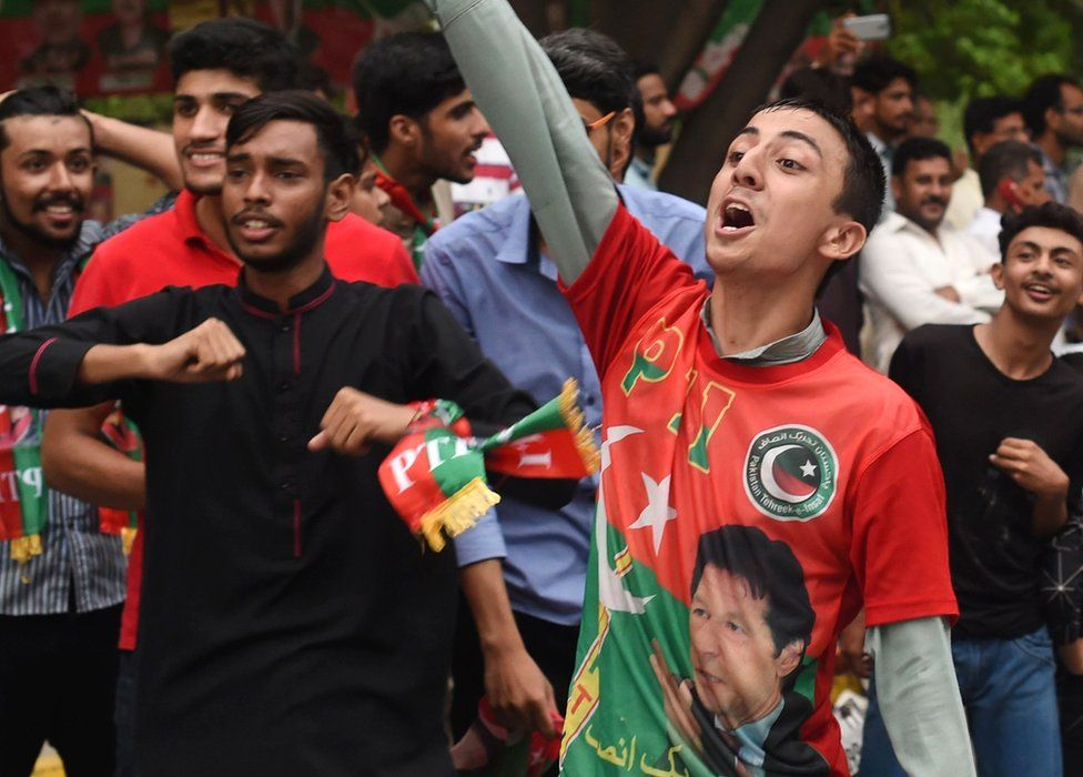 Supporters of Pakistani cricket star-turned-politician and head of the Pakistan Tehreek-e-Insaf (PTI) Imran Khan cheer as they take to the streets to celebrate after polls closed during Pakistan's general election, Lahore, 25 July 2018
