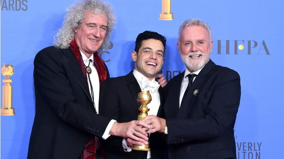 Brian May and Roger Taylor of Queen with Rami Malek