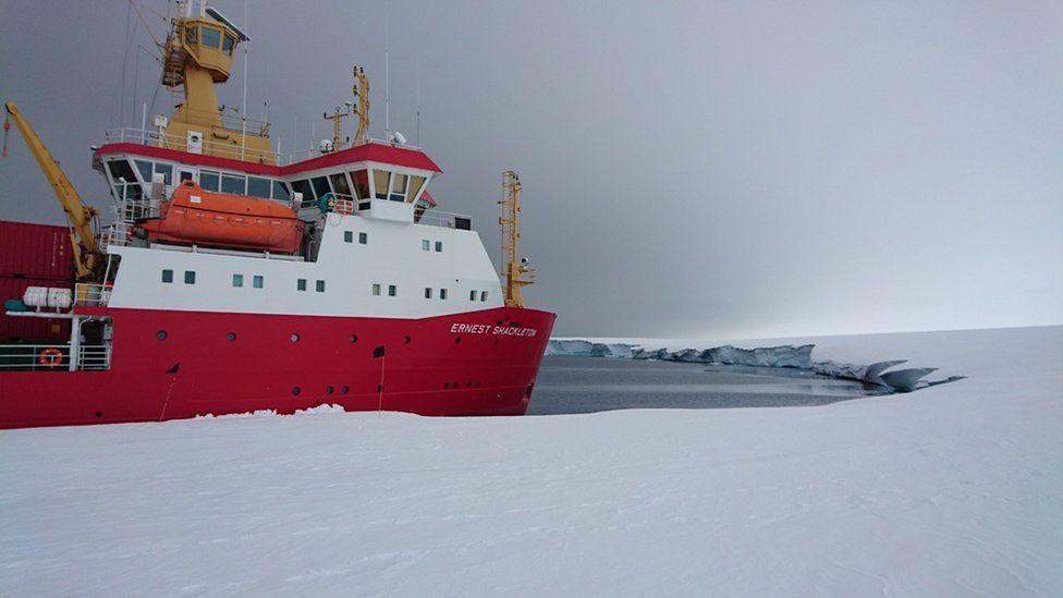 ship moored alongside ice