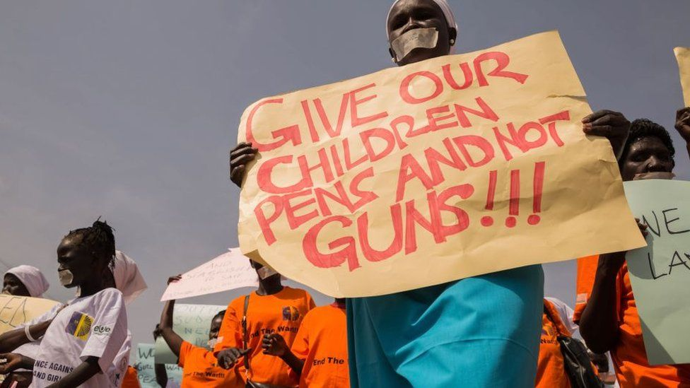 South Sudan protester holding a placard