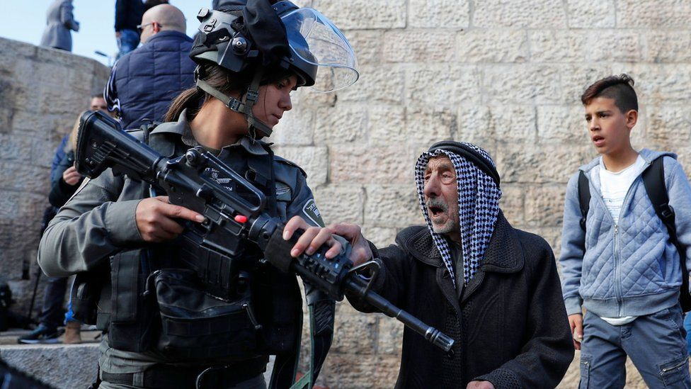 Palestinian man and Israeli soldier outside Damascus Gate in Jerusalem on 7 December 2017