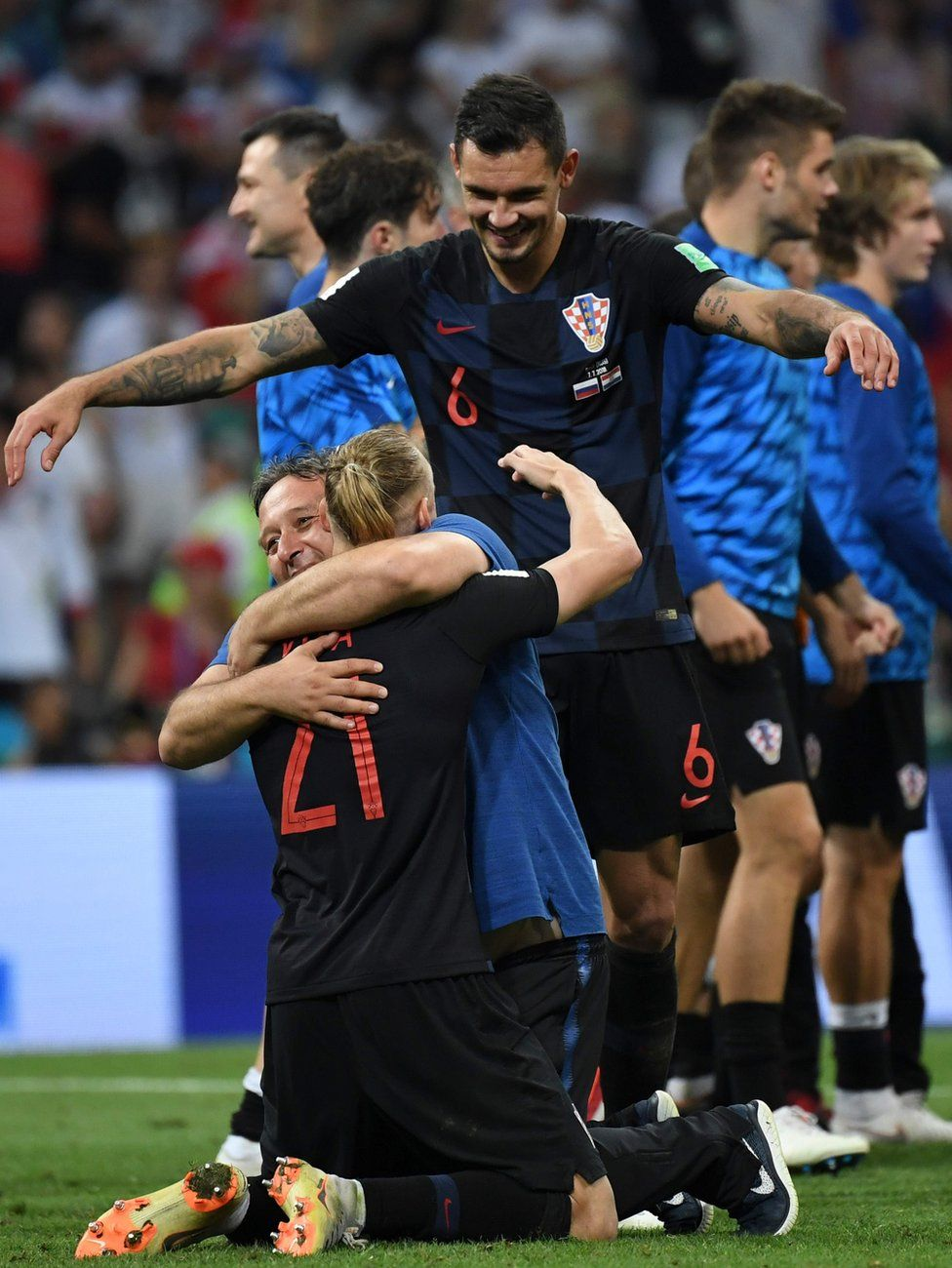 Croatia's players celebrate their win against Russia in the World Cup quarter final match, 7 July 2018