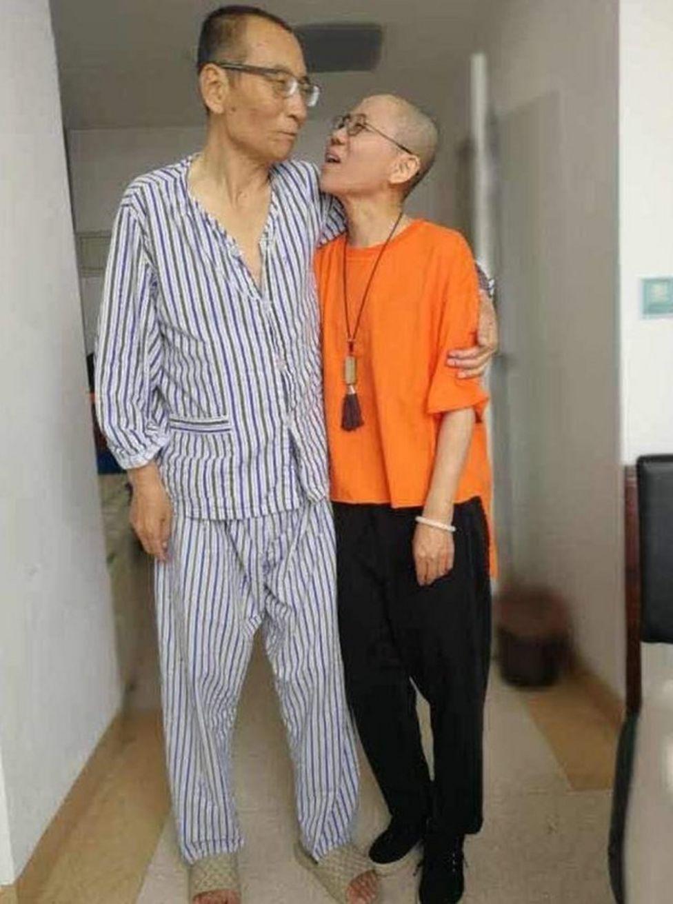 Liu Xiaobo and Liu Xia, he in pyjamas and she in outdoor clothes