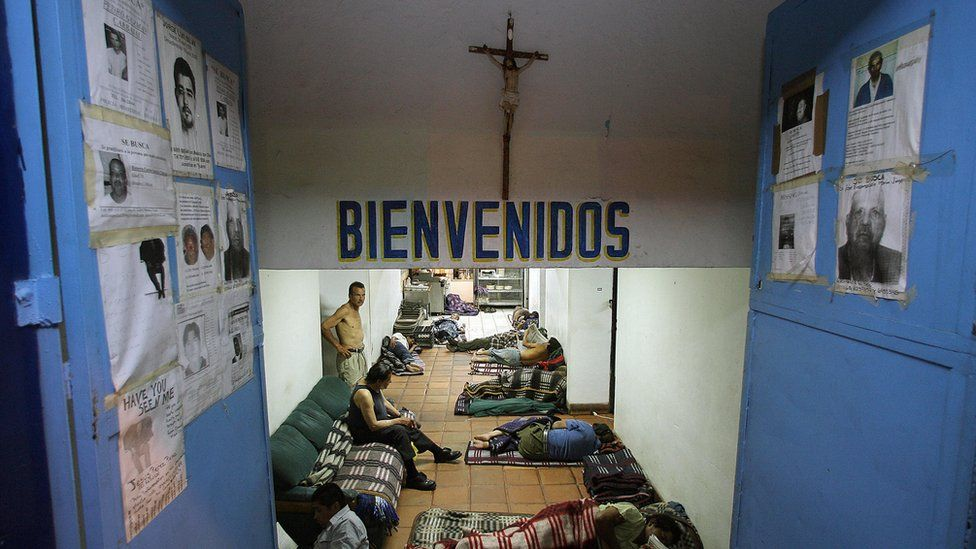 Mexican and Central American immigrants rest on the floor of a shelter for immigrants, close to the US-Mexico border in Tijuana