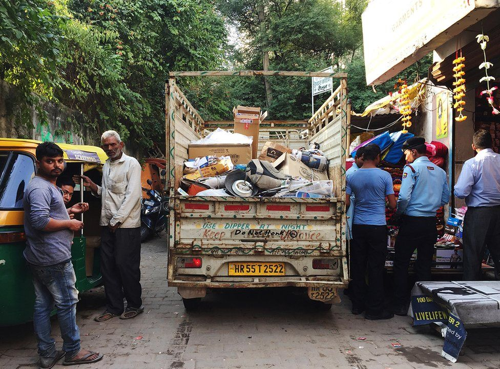 Govind's white van in which he collects all the scrap.