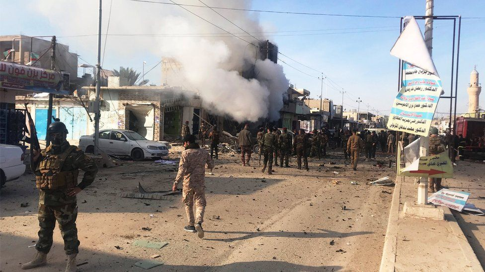 Aftermath of car bomb attack in western Iraqi border town of al-Qaim on 11 January 2019