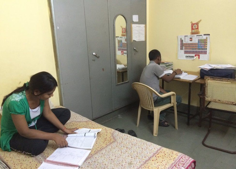 Students studying in their room