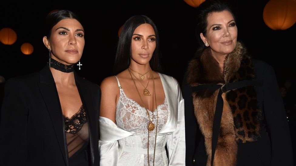 Kim Kardashian West, her sister Kourtney and mother Kris Jenner at the Givenchy show hours before the robbery