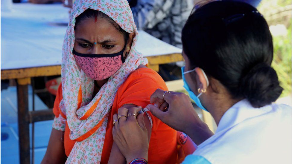 A woman being vaccinated in India