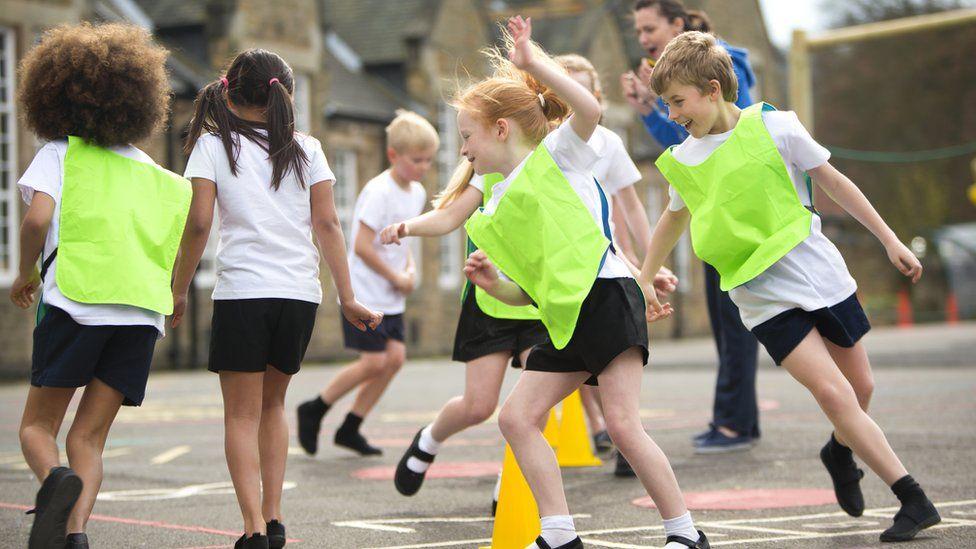 Children practising sport in school