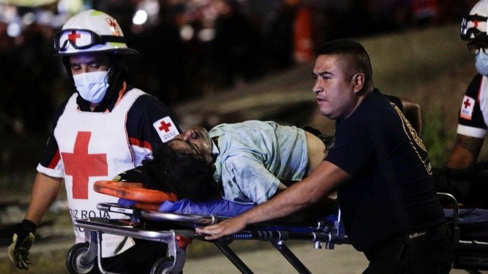 Rescuer workers carry an injured person on a stretcher in Mexico City, Mexico. Photo: 4 May 2021