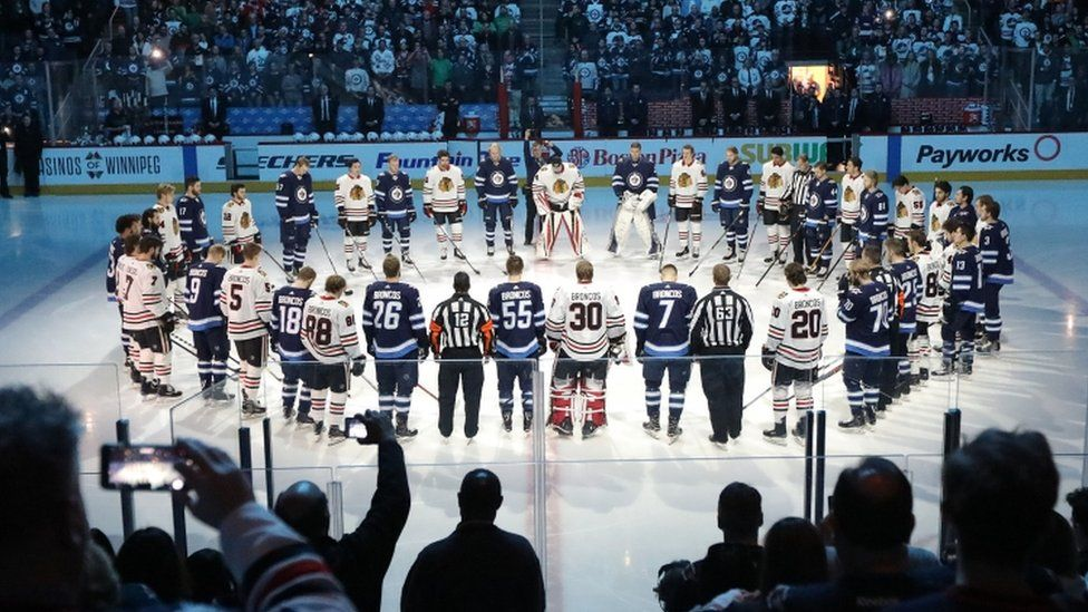Winnipeg Jets and Chicago Blackhawks players honour crash victims before Saturday's game