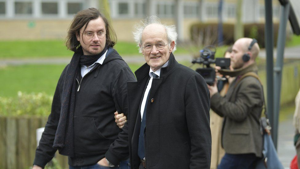 Julian Assange's brother and father - arriving at court