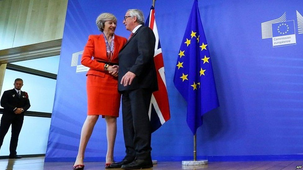 Theresa May is holding talks with Jean-Claude Juncker
