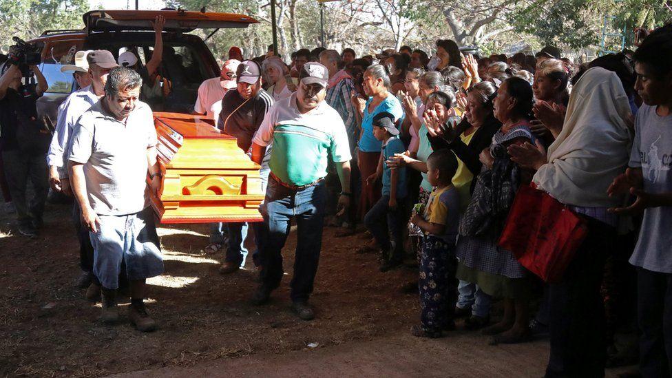 Men carrying Samir Flores Soberanes coffin