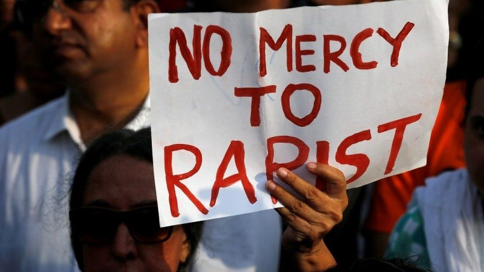 People participate in a protest against the rape of an eight-year-old girl in Kathua near Jammu, and a teenager in Unnao, Uttar Pradesh state, in Mumbai, India, April 15, 2018