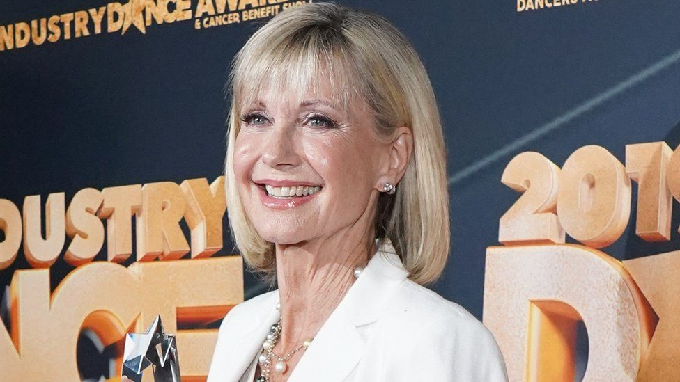 """The Sun dubbed the Grease star """"Olivia Newton Gong"""""""