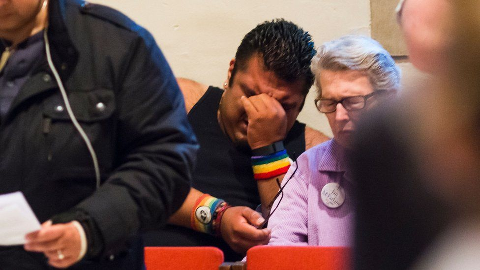 Alex Possner cries during a prayer against homophobia and gun violence at All Saints Church in Pasadena, California, in reaction to the mass shooting at a gay nightclub in Orlando, Florida.