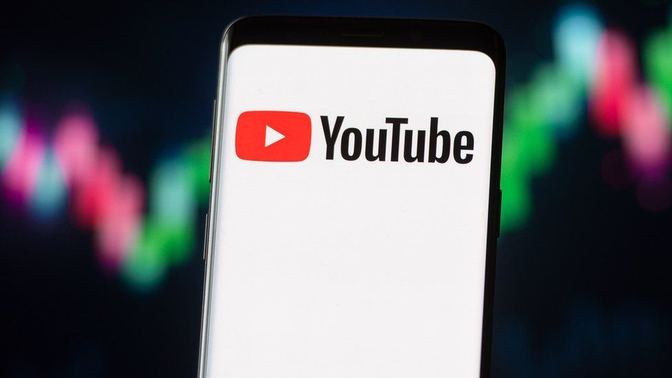 YouTube logo on a phone