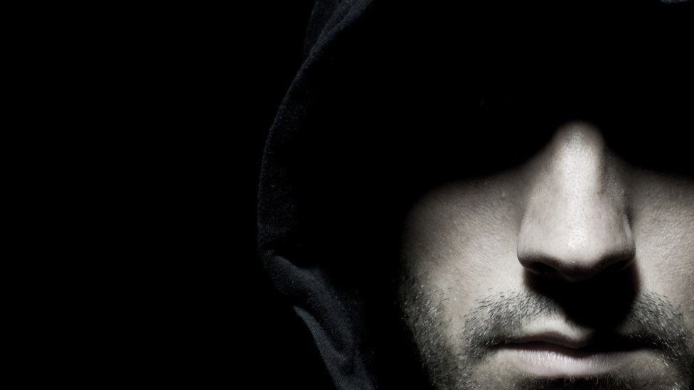 Anonymous hooded man