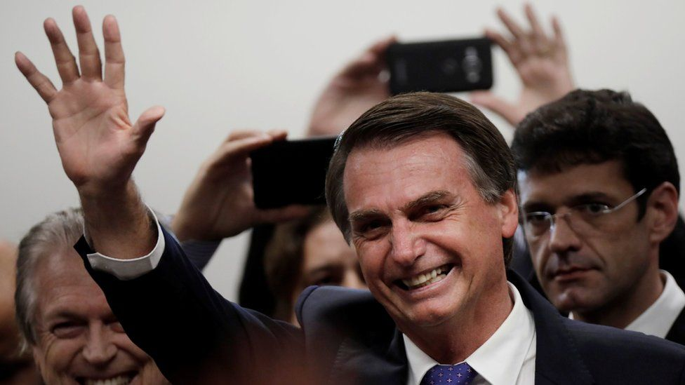 Presidential candidate Jair Bolsonaro waves to crowds during a ceremony in Brasilia, Brazil on 7 March 2018